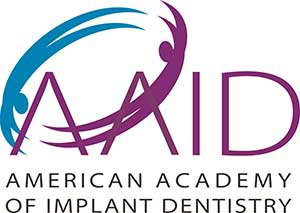 American Academy of Implant Dentistry Logo tooth implant dentistry Edmonds and Shoreline