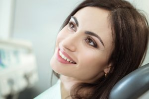 Smiling Woman In a Dentist chair